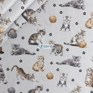 Kittens with yarns on a light grey background